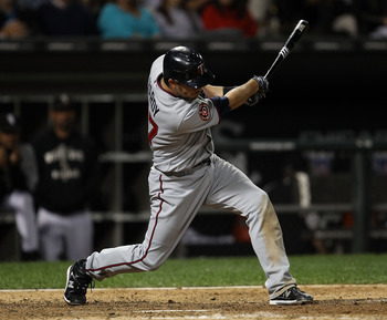 CHICAGO - SEPTEMBER 14:  J.J. Hardy #27 of the Minnesota Twins hits a double in the 5th inning against the Chicago White Sox at U.S. Cellular Field on September 14, 2010 in Chicago, Illinois.  (Photo by Jonathan Daniel/Getty Images)
