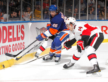 UNIONDALE, NY - FEBRUARY 05:  Matt Moulson #26 of the New York Islanders passes the puck during an NHL hockey game against the Ottawa Senators at Nassau Coliseum on February 5, 2011 in Uniondale, New York.  (Photo by Paul Bereswill/Getty Images)