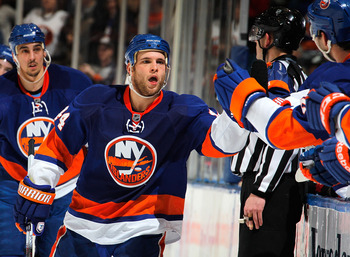 UNIONDALE, NY - FEBRUARY 05:  Rob Schremp #44 of the New York Islanders celebrates his goal with teammates during the first period of an NHL hockey game against the Ottawa Senators at the Nassau Coliseum on February 5, 2011 in Uniondale, New York.  (Photo