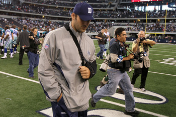 ARLINGTON, TX - OCTOBER 31:  Injured quarterback Tony Romo of the Dallas Cowboys walks off the field with his head down after the Cowboys lost 35-17 against the Jacksonville Jaguars at Cowboys Stadium on October 31, 2010 in Arlington, Texas.  (Photo by St