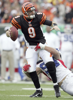 CINCINNATI - DECEMBER 24:  Carson Palmer #9 of the Cincinnati Bengals is sacked by Aaron Schobel #94 of the Buffalo Bills during the NFL game at Paul Brown Stadium on December 24, 2005 in Cincinnati, Ohio. The Bills won 37-27.  (Photo by Andy Lyons/Getty