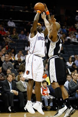 CHARLOTTE, NC - JANUARY 15:  Stephen Jackson #1 of the Charlotte Bobcats shoots over Keith Bogans #10 of the San Antonio Spurs during the game on January 15, 2010 at Time Warner Cable Arena in Charlotte, North Carolina.  The Bobcats won 92-76.  NOTE TO US