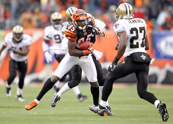 CINCINNATI, OH - DECEMBER 05:  Chad Ochocinco #85 of the Cincinnati Bengals is tackled by Tracy Porter#22 of the New Orleans Saints during the NFL game at Paul Brown Stadium on December 5, 2010 in Cincinnati, Ohio.  The Saints won 34-30.  (Photo by Andy L