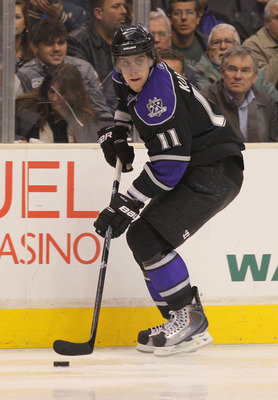 LOS ANGELES, CA - JANUARY 26:  Anze Kopitar #11 of the Los Angeles Kings controls the puck against the San Jose Sharks at Staples Center on January 26, 2011 in Los Angeles, California.  (Photo by Victor Decolongon/Getty Images)