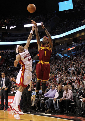 MIAMI, FL - DECEMBER 15:  Daniel Gibson #1 of the Cleveland Cavaliers shoots over Eddie House #55 of the Miami Heat  during a game at American Airlines Arena on December 15, 2010 in Miami, Florida. NOTE TO USER: User expressly acknowledges and agrees that