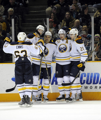 SAN JOSE, CA - JANUARY 6:  Jochen Hecht #55 of the Buffalo Sabres scores a goal against the San Jose Sharks and celebrates with his teammates in the first period  during an NHL hockey game at the HP Pavilion on January 6, 2011 in San Jose, California. The