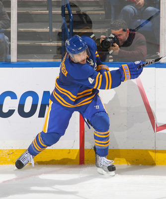 BUFFALO, NY - NOVEMBER 26: Steve Montador #4 of the Buffalo Sabres clears the puck  against the Toronto Maple Leafs at HSBC Arena on November 26, 2010 in Buffalo, New York. Buffalo won 3-1.  (Photo by Rick Stewart/Getty Images)