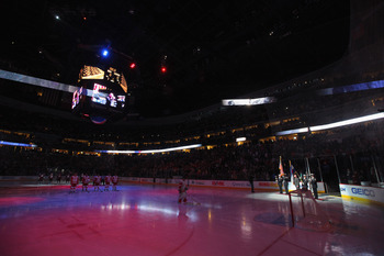 DENVER, CO - JANUARY 10:  The national anthem is performed by Jake Schroeder as the Detroit Red Wings take the ice to face the Colorado Avalanche at the Pepsi Center on January 10, 2011 in Denver, Colorado. The Avalanche defeated the Red Wings 5-4.  (Phot