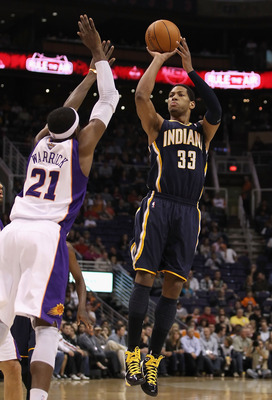 PHOENIX - DECEMBER 03:  Danny Granger #33 of the Indiana Pacers puts up a shot over Hakim Warrick #21 of the Phoenix Suns during the NBA game at US Airways Center on December 3, 2010 in Phoenix, Arizona.  The Suns defeated the Pacers 107-97.  NOTE TO USER