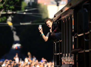 SAN FRANCISCO - NOVEMBER 03:  Matt Cain of the San Francisco Giants takes video of the crowd during the San Francisco Giants victory parade on November 3, 2010 in San Francisco, California.  (Photo by Ezra Shaw/Getty Images)