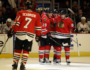 CHICAGO - OCTOBER 13: Patrick Kane #88 of the Chicago Blackhawks (R) celebrates a 1st period goal with teammates (L-R) Brent Seabrook #7, Jonathan Toews #19 and Duncan Keith #2 against the Nashville Predators at the United Center on October 13, 2010 in Ch