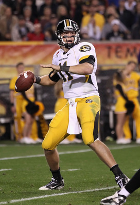 TEMPE, AZ - DECEMBER 28:  Quarterback Blaine Gabbert #11 of the Missouri Tigers drops back to pass during the Insight Bowl against the Iowa Hawkeyes  at Sun Devil Stadium on December 28, 2010 in Tempe, Arizona.  The Hawkeyes defeated the Tigers 27-24.  (P