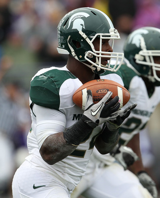 EVANSTON, IL - OCTOBER 23: Le'Veon Bell #24 of the Michigan State Spartan sfields a kick-off against the Northwestern Wildcats at Ryan Field on October 23, 2010 in Evanston, Illinois. Michigan State defeated Northwestern 35-27. (Photo by Jonathan Daniel/G