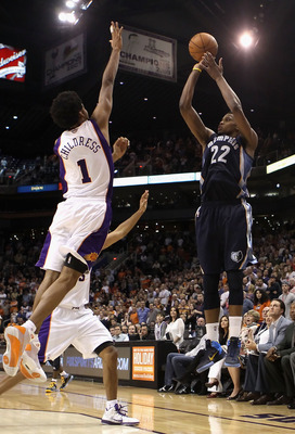 PHOENIX - DECEMBER 08:  Rudy Gay #22 of the Memphis Grizzlies puts up the game tying three point shot over Josh Childress #1 of the Phoenix Suns at the end of regulation in the NBA game at US Airways Center on December 8, 2010 in Phoenix, Arizona. The Gri