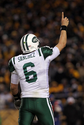PITTSBURGH, PA - JANUARY 23:  Quarterback Mark Sanchez #6 of the New York Jets gestures after he threw a touchdown pas against the Pittsburgh Steelers during the 2011 AFC Championship game at Heinz Field on January 23, 2011 in Pittsburgh, Pennsylvania. Th