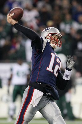 FOXBORO, MA - JANUARY 16:  Quarterback Tom Brady #12 of the New England Patriots throws a pass during their 2011 AFC divisional playoff game against the New York Jets at Gillette Stadium on January 16, 2011 in Foxboro, Massachusetts.  (Photo by Elsa/Getty