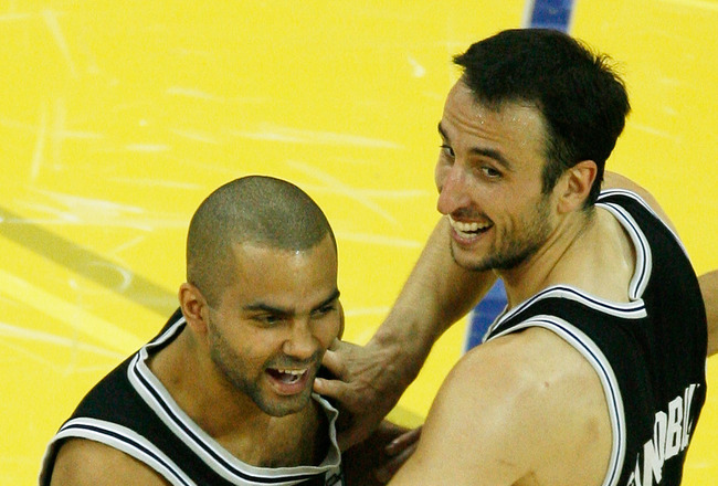 CLEVELAND - JUNE 14: Manu Ginobili #20 and Tony Parker #9 of the San Antonio Spurs celebrate their 83-82 victory over the Cleveland Cavaliers to win Game Four of the NBA Finals on June 14, 2007 at the Quicken Loans Arena in Cleveland, Ohio. NOTE TO USER:
