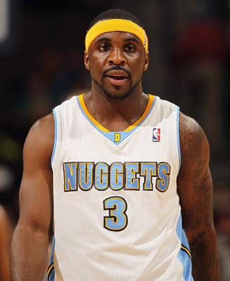 DENVER, CO - JANUARY 13:  Ty Lawson #3 of the Denver Nuggets looks on during a break in the action against the Miami Heat at the Pepsi Center on January 13, 2011 in Denver, Colorado. The Nuggets defeated the Heat 130-102. NOTE TO USER: User expressly ackn