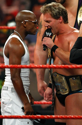 LAS VEGAS - AUGUST 24:  Boxer Floyd Mayweather Jr. (L) stares down wrestler Chris Jericho during the WWE Monday Night Raw show at the Thomas & Mack Center August 24, 2009 in Las Vegas, Nevada. Mayweather was a special guest host during the broadcast.  (Ph