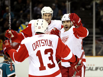 SAN JOSE, CA - NOVEMBER 30:  Henrik Zetterberg #40 celebrates with Pavel Datsyuk #13 and Jonathan Ericsson #52 of the Detroit Red Wings after Zetterberg scored a goal against the San Jose Sharks at HP Pavilion on November 30, 2010 in San Jose, California.