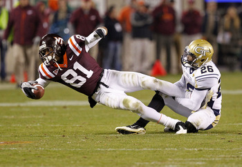 BLACKSBURG, VA - NOVEMBER 04: Wide receiver Jarrett Boykin #81 of the Virginia Tech Hokies dives after catching the ball as cornerback Dominique Reese #26 of the Georgia Tech Yellow Jackets makes the tackle at Lane Stadium on November 4, 2010 in Blacksbur