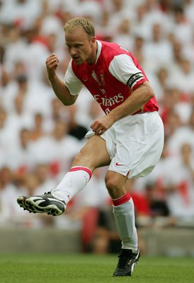 LONDON - JULY 22:  Dennis Bergkamp of Arsenal shoots on goal during the Dennis Bergkamp testimonial match between Arsenal and Ajax at the Emirates Stadium on July 22, 2006 in London, England.  (Photo by Jamie McDonald/Getty Images)