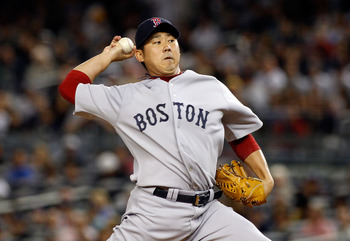 NEW YORK - SEPTEMBER 26:  Daisuke Matsuzaka #18 of the Boston Red Sox delivers a pitch in the first-inning against the New York Yankees on September 26, 2010 at Yankee Stadium in the Bronx borough of New York City.  (Photo by Mike Stobe/Getty Images)