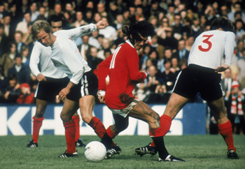 LONDON - AUGUST 8:  George Best of Manchester United finds no way past the Fulham defence during a Pre-Season Friendly match between Fulham and Manchester United held on August 8, 1971 at Craven Cottage, in London. (Photo by Getty Images)