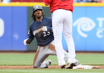 CINCINNATI - MAY 18:  Rickie Weeks #23 of the Milwaukee Brewers reacts after being tagged out while attempting to steal second base by Orlando Cabrera #2 of the Cincinnati Reds during the game at Great American Ball Park on May 18, 2010 in Cincinnati, Ohi