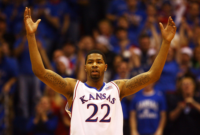 LAWRENCE, KS - DECEMBER 19:  Marcus Morris #22 of the Kansas Jayhawks celebrates after scoring during the game against the Mighigan Wolverines on December 19, 2009 at Allen Fieldhouse in Lawrence, Kansas.  (Photo by Jamie Squire/Getty Images)