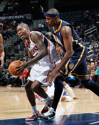 ATLANTA, GA - DECEMBER 11:  Jamal Crawford #11 of the Atlanta Hawks draws a foul from James Posey #41 of the Indiana Pacers at Philips Arena on December 11, 2010 in Atlanta, Georgia.  NOTE TO USER: User expressly acknowledges and agrees that, by downloadi