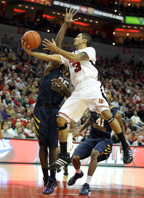 LOUISVILLE, KY - JANUARY 26:  Peyton Siva #3 of the Louisville Cardinals shoots the ball while defended by Darryl Bryant #25 of the West Virginia Mountaineers during the Big East Conference game at the KFC Yum! Center on January 26, 2011 in Louisville, Ke