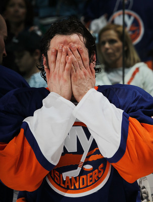 UNIONDALE, NY - APRIL 11: Mark Streit #2 of the New York Islanders prepares for post game event following the Islanders overtime loss to the Pittsburgh Penguins at the Nassau Coliseum on April 11, 2010 in Uniondale, New York. (Photo by Bruce Bennett/Getty
