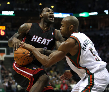 MILWAUKEE, WI - DECEMBER 06: LeBron James #6 of the Miami Heat is fouled by Corey Maggette #5 of the Milwaukee Bucks at the Bradley Center on December 6, 2010 in Milwaukee, Wisconsin. The Heat defeated the Bucks 88-78. NOTE TO USER: User expressly acknowl