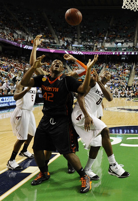 GREENSBORO, NC - MARCH 12:  Jeff Allen #00 of the Virginia Tech Hokies fights for a loose ball with Reggie Johnson #42 of the University of Miami Hurricanes in their quarterfinal game in the 2010 ACC Men's Basketball Tournament at the Greensboro Coliseum