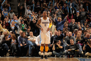 DENVER, CO - JANUARY 13:  J.R. Smith #5 of the Denver Nuggets celebrates a three point basket against the Miami Heat at the Pepsi Center on January 13, 2011 in Denver, Colorado. The Nuggets defeated the Heat 130-102. NOTE TO USER: User expressly acknowled