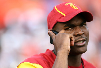 PASADENA, CA - JANUARY 01:  Former USC Trojan receiver Keyshawn Johnson talks on his mobile phone on the field prior to the Rose Bowl presented by Citi against the Illinois Fighting Illini at the Rose Bowl on January 1, 2008 in Pasadena, California. The T