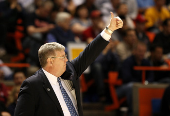 BOISE, ID - MARCH 20:  Head Coach Stew Morrill of the Utah State Aggies adjusts his team during the game against the Marquette Golden Eagles in the first round of the NCAA Division I Men's Basketball Tournament at the Taco Bell Arena on March 20, 2009 in