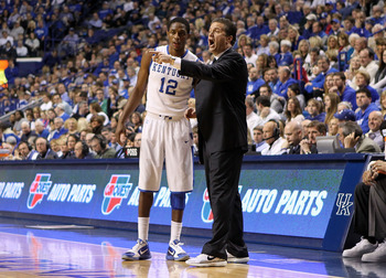 LEXINGTON, KY - JANUARY 29:  John Calipari the Head Coach of the Kentucky Wildcats gives instructions to Brandon Knight #12 during the SEC game against the Georgia Bulldogs at Rupp Arena on January 29, 2011 in Lexington, Kentucky. Kentucky won 66-60.  (Ph