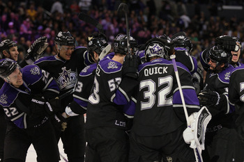 LOS ANGELES, CA - JANUARY 26:  Jonathan Quick #32 of the Los Angeles Kings celebrates with teammates after defeating the San Jose Sharks 3-2 in an overtime shootout at Staples Center on January 26, 2011 in Los Angeles, California.  (Photo by Victor Decolo