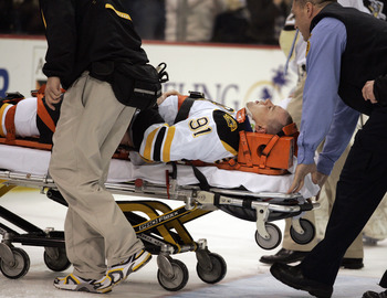 PITTSBURGH, PA - MARCH 07:  Marc Savard #91 of the Boston Bruins is taken off the ice by medical staff after being injured in the third period against the Pittsburgh Penguins at Mellon Arena on March 7, 2010 in Pittsburgh, Pennsylvania.  The Penguins defe
