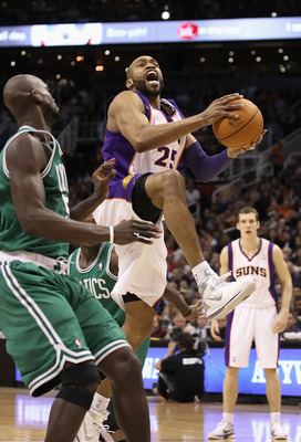 PHOENIX, AZ - JANUARY 28:  Vince Carter #25 of the Phoenix Suns drives the ball during the NBA game against the Boston Celtics at US Airways Center on January 28, 2011 in Phoenix, Arizona. The Suns defeated the Celtics 88-71. NOTE TO USER: User expressly