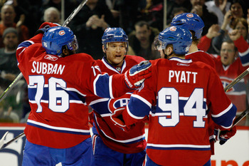 MONTREAL, CANADA - FEBRUARY 2:  Jeff Halpern #15 of the Montreal Canadiens celebrates his second-period goal with teammates during a NHL game against the Florida Panthers at the Bell Centre on February 2, 2011 in Montreal, Quebec, Canada.  (Photo by Richa