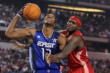 ARLINGTON, TX - FEBRUARY 14:  Dwight Howard #12 of the Eastern Conference smiles  while playing against Zach Randolph #50 of the Western Conference during the first half of the NBA All-Star Game, part of 2010 NBA All-Star Weekend at Cowboys Stadium on Feb