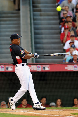 ANAHEIM, CA - JULY 11:  Former MLB player Ozzie Smith at bat during the MLB All Star Game Celebrity Softball Game at Angels Stadium of Anaheim on July 11, 2010 in Anaheim, California.  (Photo by Michael Buckner/Getty Images)