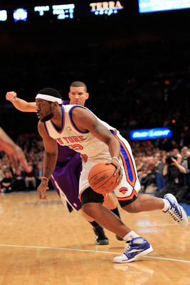 NEW YORK, NY - JANUARY 14: Bill Walker #5 of the New York Knicks drives against the Sacramento Kings at Madison Square Garden on January 14, 2011 in New York City. NOTE TO USER: User expressly acknowledges and agrees that, by downloading and or using this
