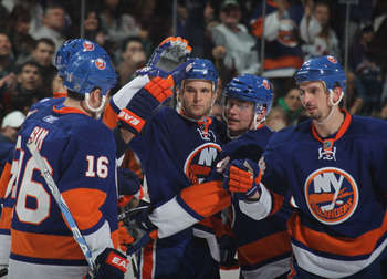 UNIONDALE, NY - DECEMBER 02: Rob Schremp #44 (C) of the New York Islanders celebrates his goal at 12:30 of the second period against the New York Rangers at the Nassau Coliseum on December 2, 2010 in Uniondale, New York.  (Photo by Bruce Bennett/Getty Ima