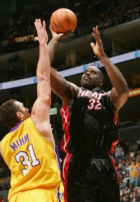 LOS ANGELES - JANUARY 16:   Shaquille O'Neal #32 of the Miami Heat shoots over Chris Mihm #31 of the Los Angeles Lakers on January 16, 2006 at Staples Center in Los Angeles, California. NOTE TO USER: User expressly acknowledges and agrees that, by downloa