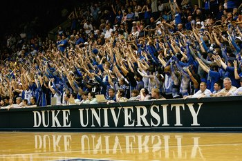 DURHAM, NC - FEBRUARY 11:  Duke Blue Devils fans hold up their hands during the game against the North Carolina Tar Heels on February 11, 2009 at Cameron Indoor Stadium in Durham, North Carolina.  (Photo by Kevin C. Cox/Getty Images)