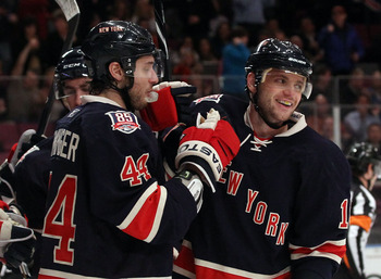 NEW YORK, NY - JANUARY 19: Steve Eminger #44 of the New York Rangers and Marian Gaborik #10 celebrate Gaborik's hat trick goal against the Toronto Maple Leafs at Madison Square Garden on January 19, 2011 in New York City.  (Photo by Bruce Bennett/Getty Im